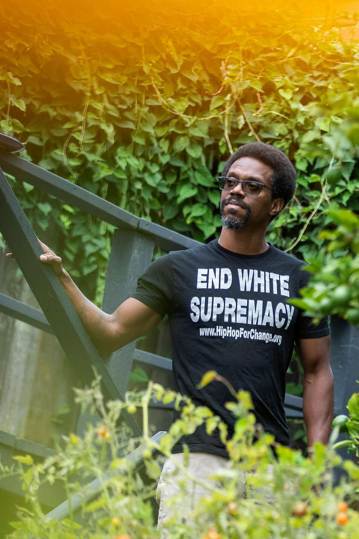 A portrait of Emile DeWeaver at his backyard on Tuesday, Aug. 4, 2020, in Oakland, Calif.