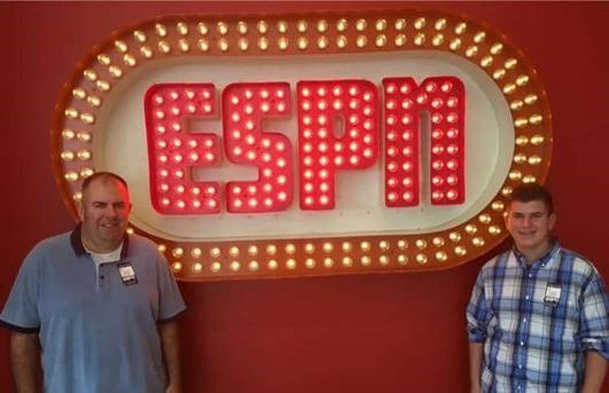 Alex Feuz, right, with his father, Mark, during a visit to ESPN's studios five years ago. (Photo courtesy Alex Feuz)