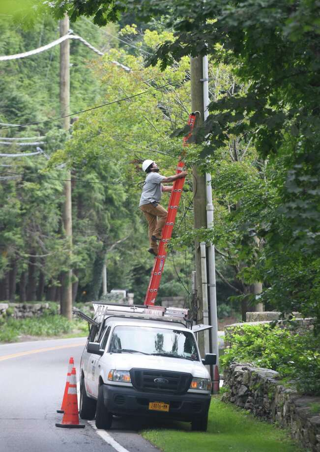 A lineman works on a power line on Riversville Road in Glenville Wednesday. section of Greenwich, Conn. Wednesday, Aug. 12, 2020. While power has been restored to most Greenwich residents since Tropical Storm Isaias hit last Tuesday, a small number still remain without power. Photo: Tyler Sizemore / Hearst Connecticut Media / Greenwich Time