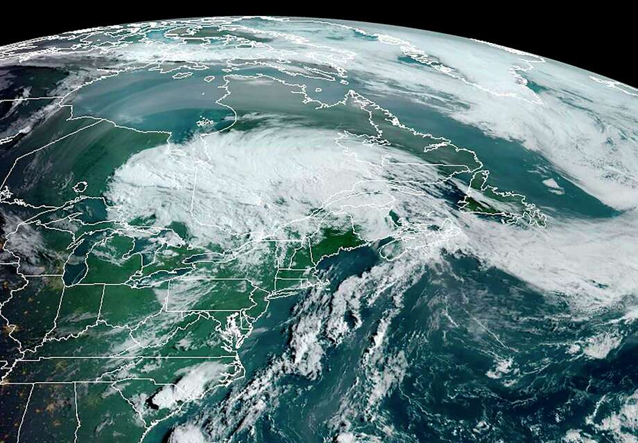 This RAMMB/NOAA satellite image obtained on August 5, 2020 at 12:00 UTC shows Tropical storm Isaias over the northeastern part of the US and southeastern Canada. Photo: HANDOUT / RAMMB /NOAA /NESDIS /AFP Via Getty Images / AFP or licensors
