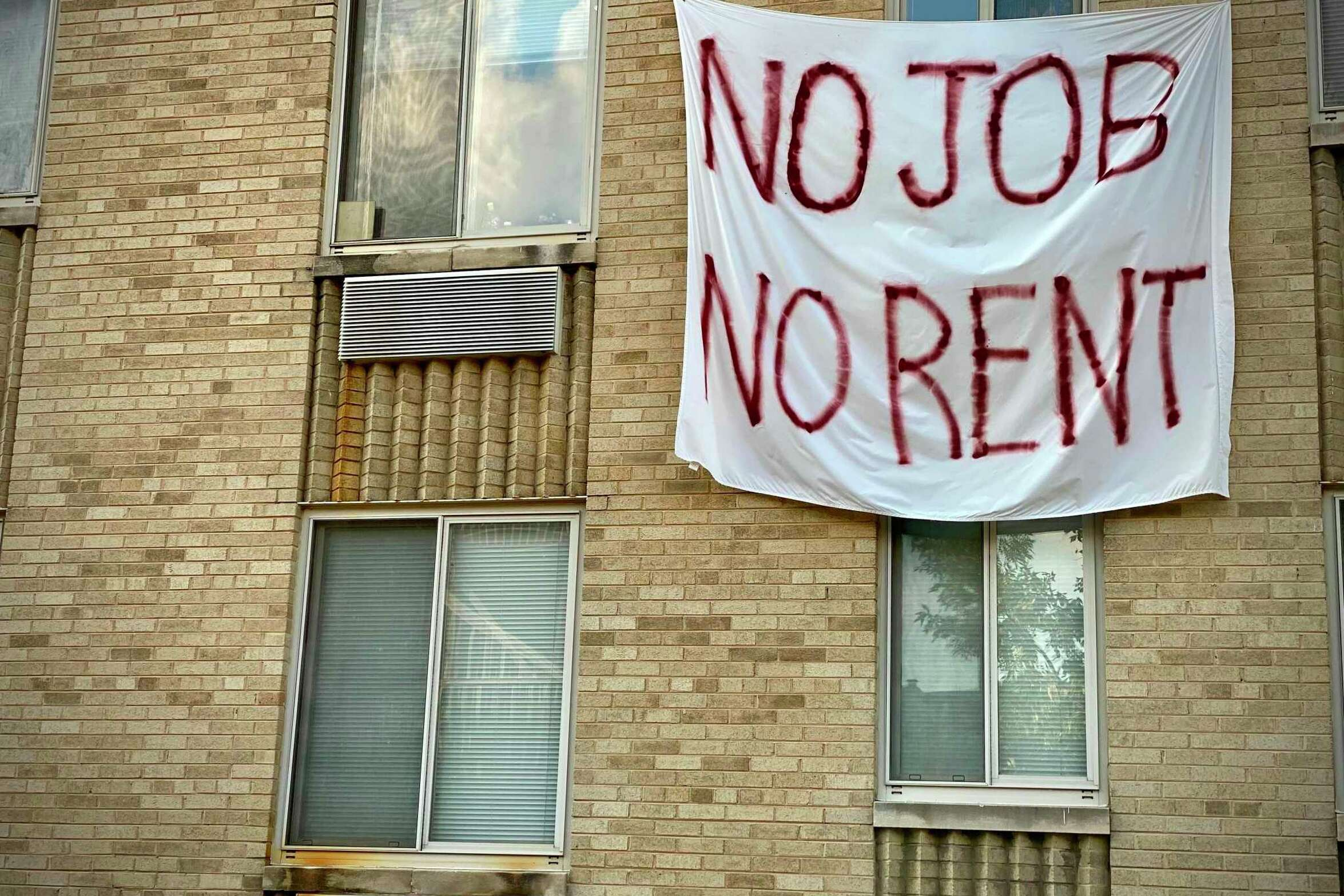 A banner against renters eviction reading no job, no rent is displayed on a controlled rent building in Washington, D.C. With double digit unemployment, disruption to businesses from social distancing rules, and persistent coronavirus spread, many Americans had been relying on relief measures approved earlier by Congress, but which mostly expired in July.