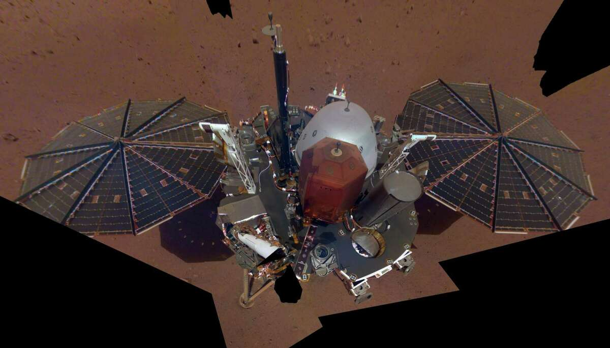 This is NASA InSight's first full selfie on Mars, taken Dec. 6, 2018. The selfie is made up of 11 images that were taken by its Instrument Deployment Camera, located on the elbow of its robotic arm. Those images were then stitched together into a mosaic.