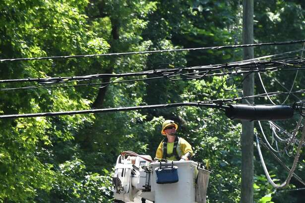 Crews repaired power lines on Doubling Road in Greenwich on Monday.