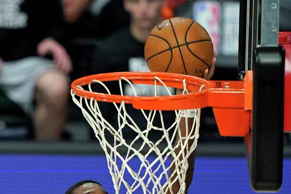 San Antonio Spurs guard Lonnie Walker IV takes a shot against the New Orleans Pelicans during the first half of an NBA basketball game, Sunday, Aug. 9, 2020, in Lake Buena Vista, Fla. (AP Photo/Ashley Landis, Pool)