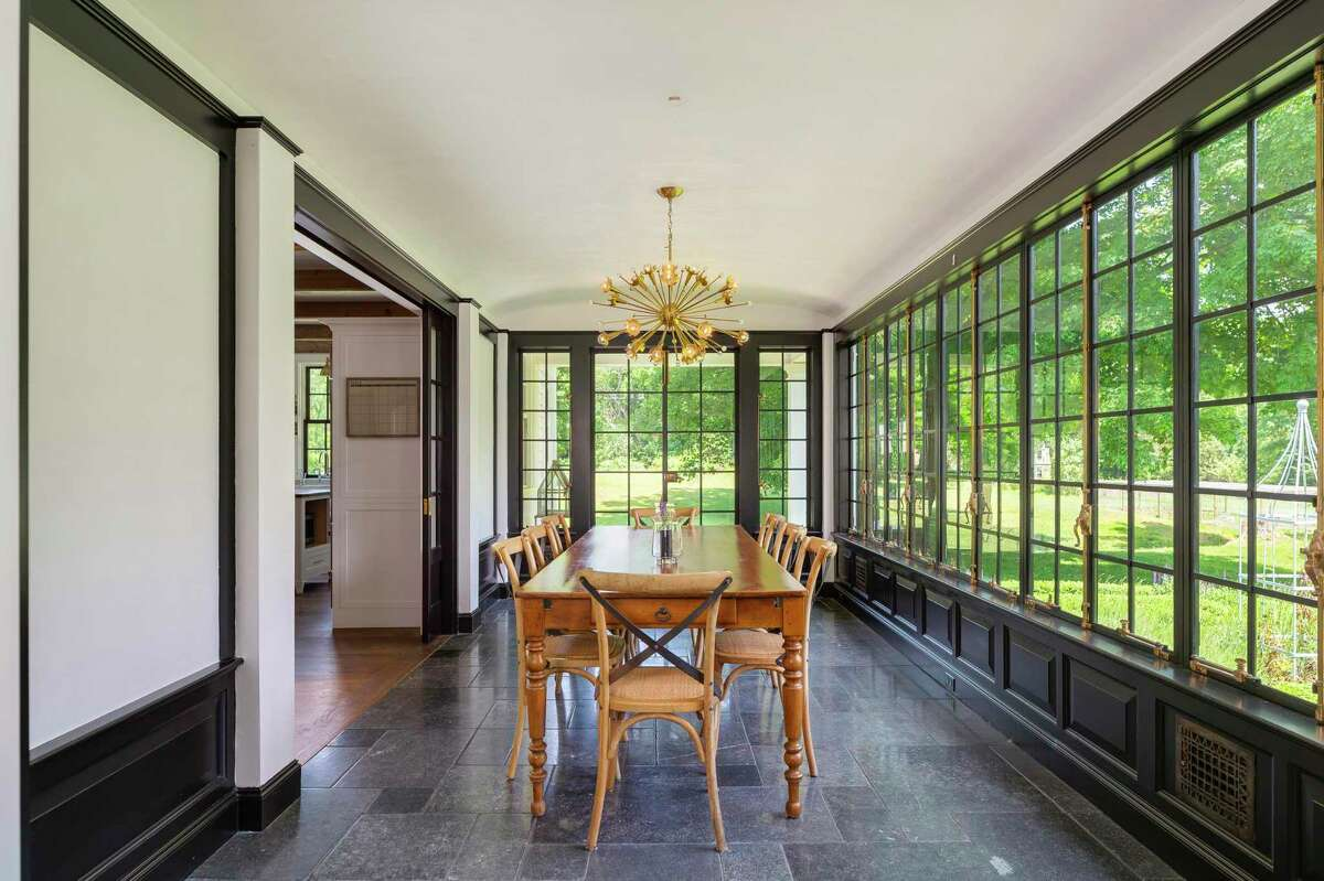 A whole wall of vintage Hopes steel-framed casement windows give the dining room a conservatory feel. Its Belgium bluestone flooring features radiant heat. Both men would stand on this private lane in disbelief and wonder at the sight of this modern day masterpiece that also honors the past. The house has undergone several major renovations, including one in 1916 by famed local architect Cameron Clark, and another early in the new millennium that earned its then-homeowners a Distinguished Achievement Award from the Southport Conservancy in 2003 for the