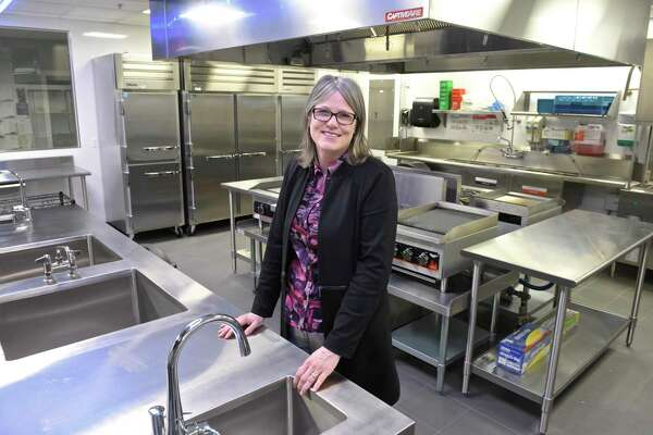 Workshop Academy Founder and Executive Director Catherine Fraise stands in the state-of-art kitchen that the school built to go with their new culinary program. Tuesday, March 12, 2019, in Bethel, Conn.