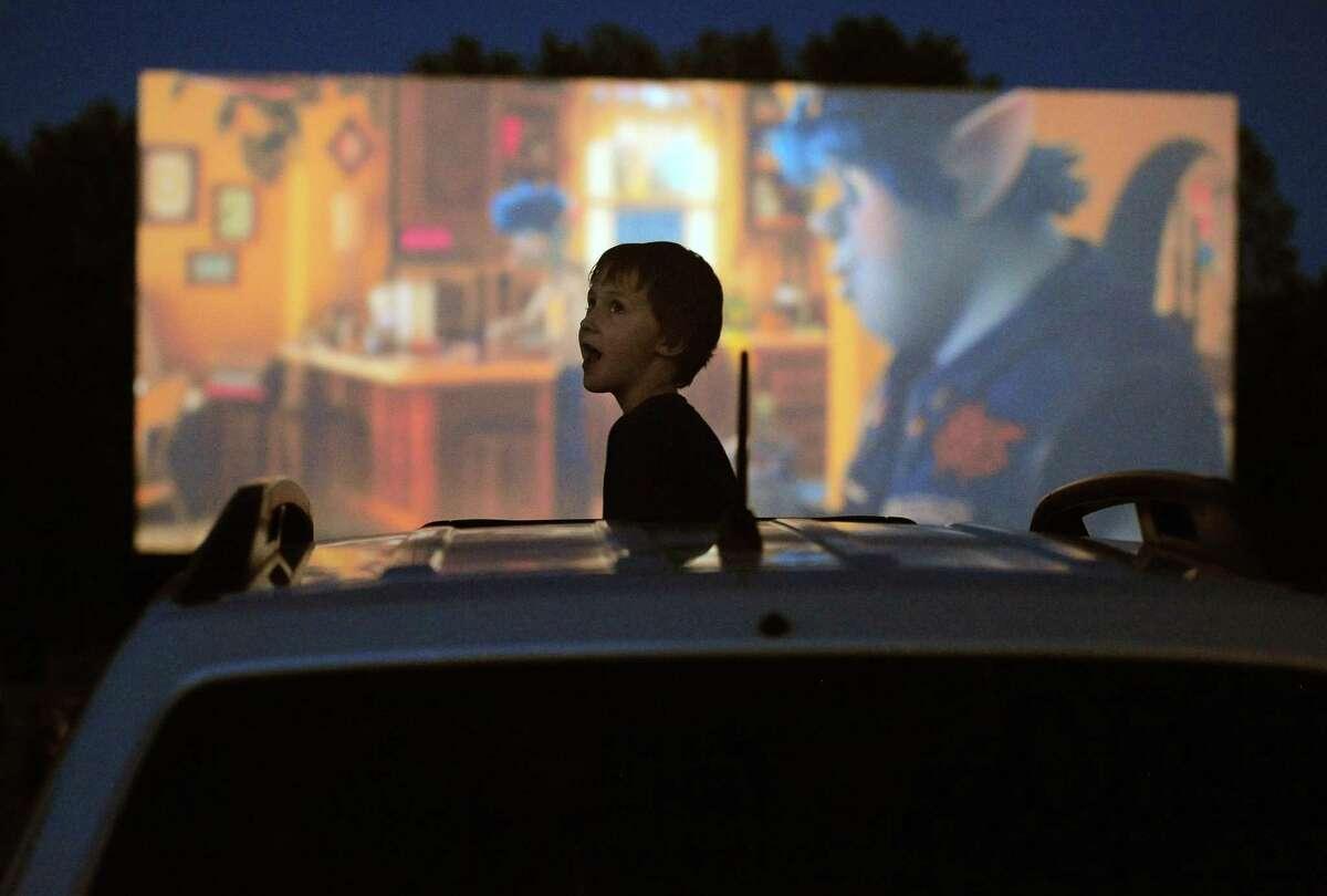Patron William Rhines, 7, of Conventry enjoys the Disney movie