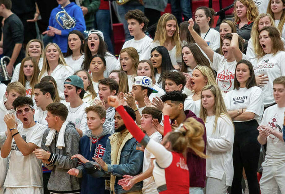 Alton students fill the Redbird Nest section of bleachers at a AHS boys basketball game in January at Alton High in Godfrey. COVID-19 concerns will prevent limit spectators at sports events hosted by Alton this fall to two per participating athlete.