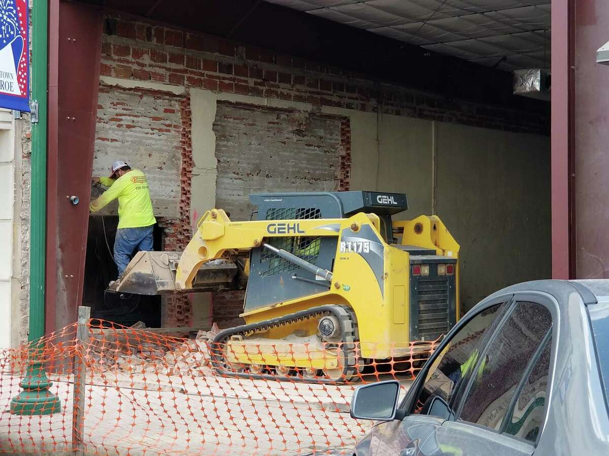 """The wall that separated the Crighton Theatre lobby from its """"kitchen"""" space was demolished last weekend, making way for a larger lobby and the reality of downstairs restrooms. Being able to accomplish these improvements without concerns about public attendance at events is one of the very few positives related to the pandemic."""