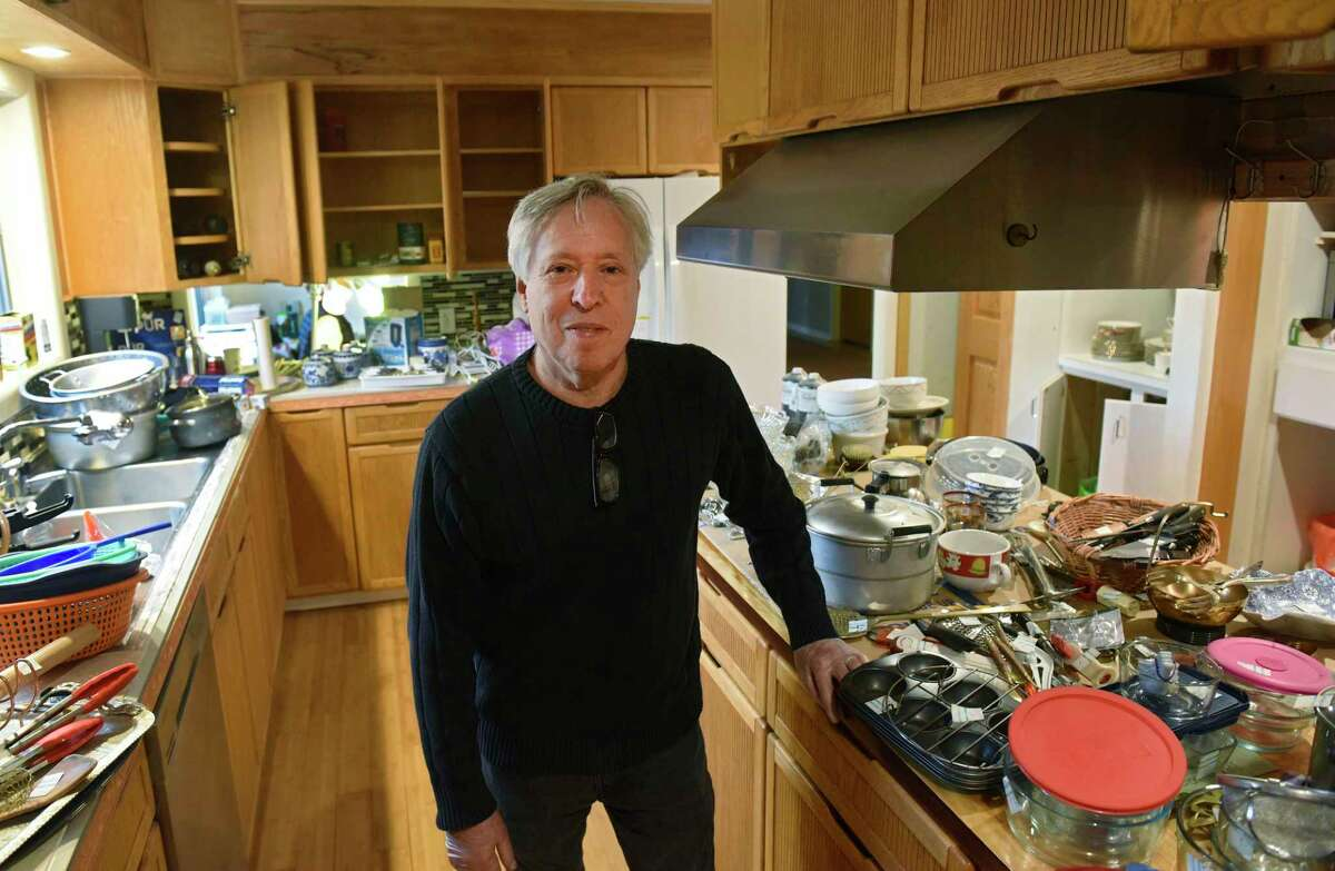 Andy Geller, owner of New Scotland Antiques, stands in the kitchen of a home where he is running an estate sale on Friday, March 13, 2020 in Menands, N.Y. (Lori Van Buren/Times Union)