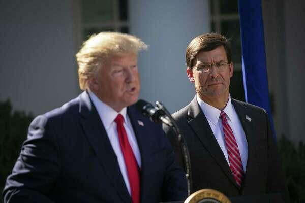 Mark Esper listens as President Donald Trump speaks outside the White House in 2019.