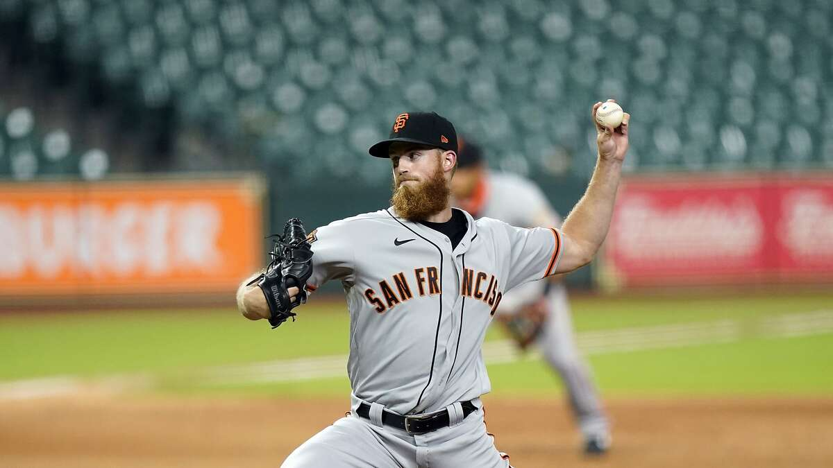 San Francisco Giants' Conner Menez throws against the Houston Astros during the fourth inning of a baseball game Monday, Aug. 10, 2020, in Houston. (AP Photo/David J. Phillip)