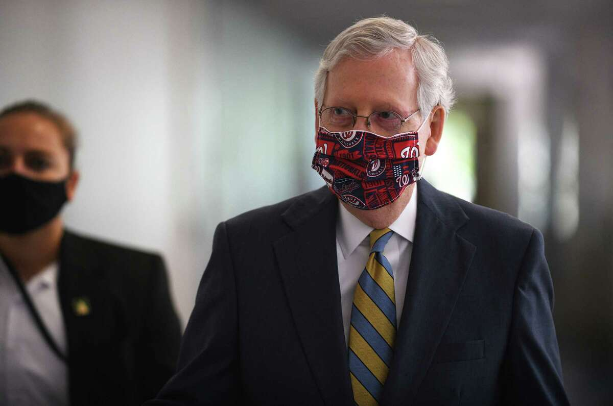 Senate Majority Leader Mitch McConnell, R-Ky., arrives for the Republican luncheon on Capitol Hill on July 23.