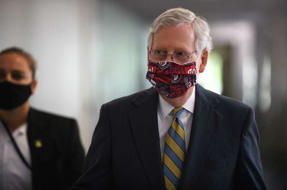 Senate Majority Leader Mitch McConnell, R-Ky., arrives for the Republican luncheon on Capitol Hill on July 23. Photo: Photo For The Washington Post By Astrid Riecken / Astrid Riecken