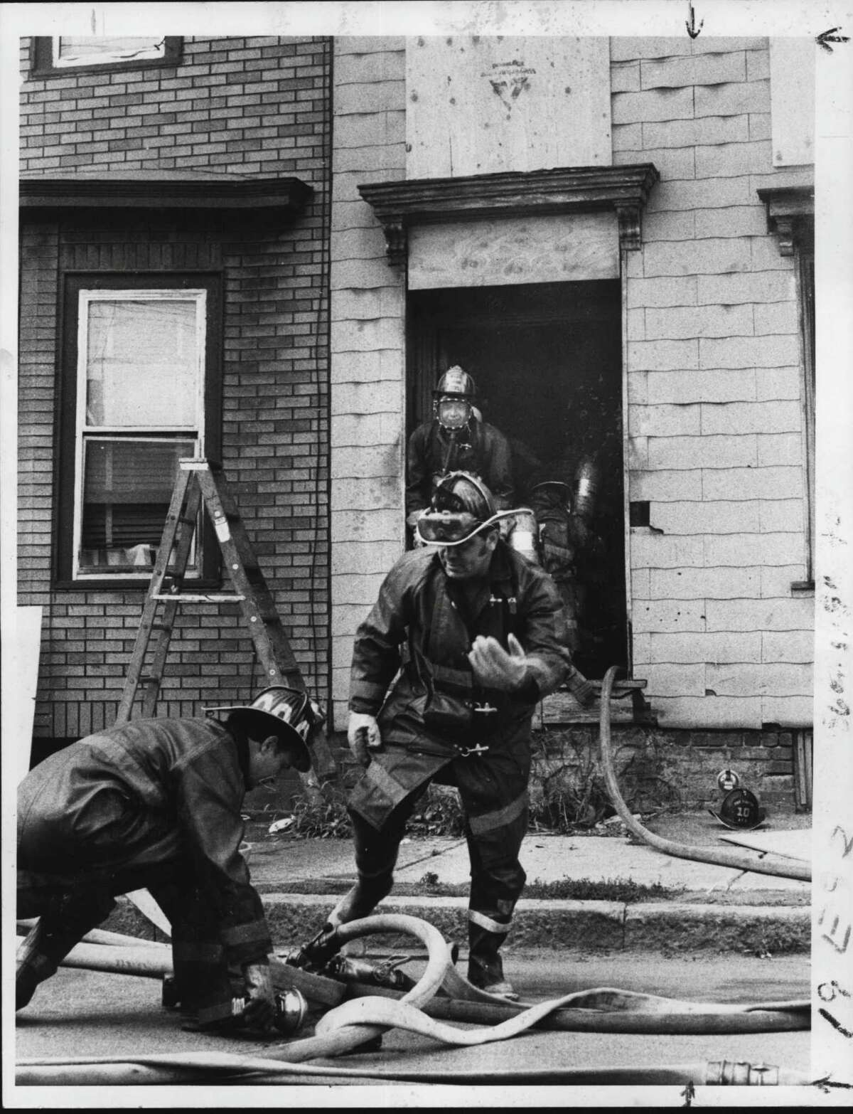 Firemen battle house fire at 476 Elk Street in Albany, New York. August 13, 1980 (Bud Hewig/Times Union Archive)