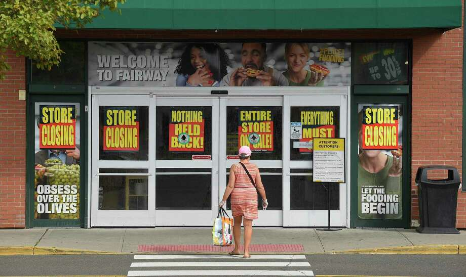 Customers of Fairway Market were greeted with store closing signs as they shopped Aug. 12 in Stamford. Photo: Matthew Brown / Hearst Connecticut Media / Stamford Advocate