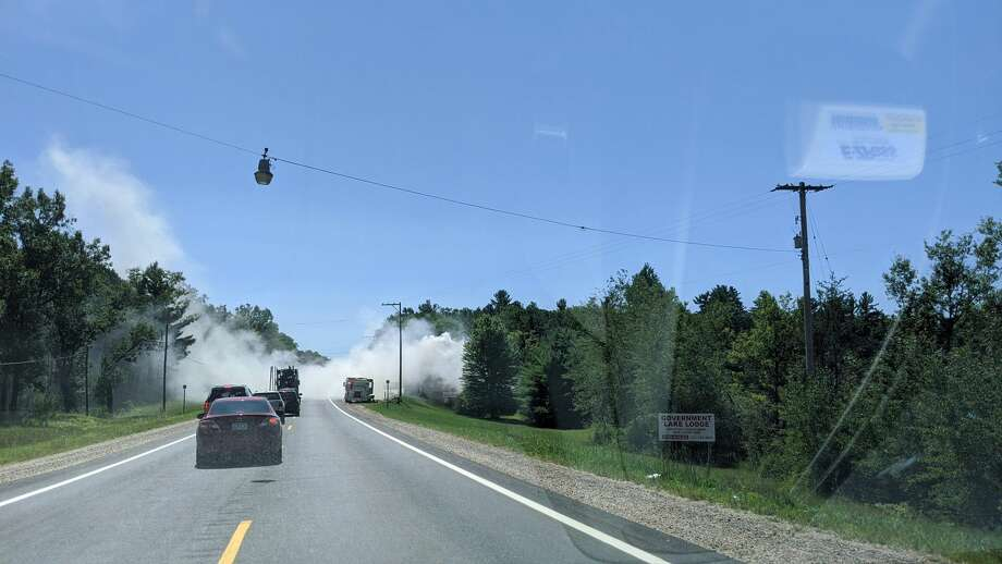 A portion of M37 is closed and traffic is being rerouted around the scene of a reported fire at the Government Lake Lodge near Baldwin. Photo: Pioneer Photo/David Roberts