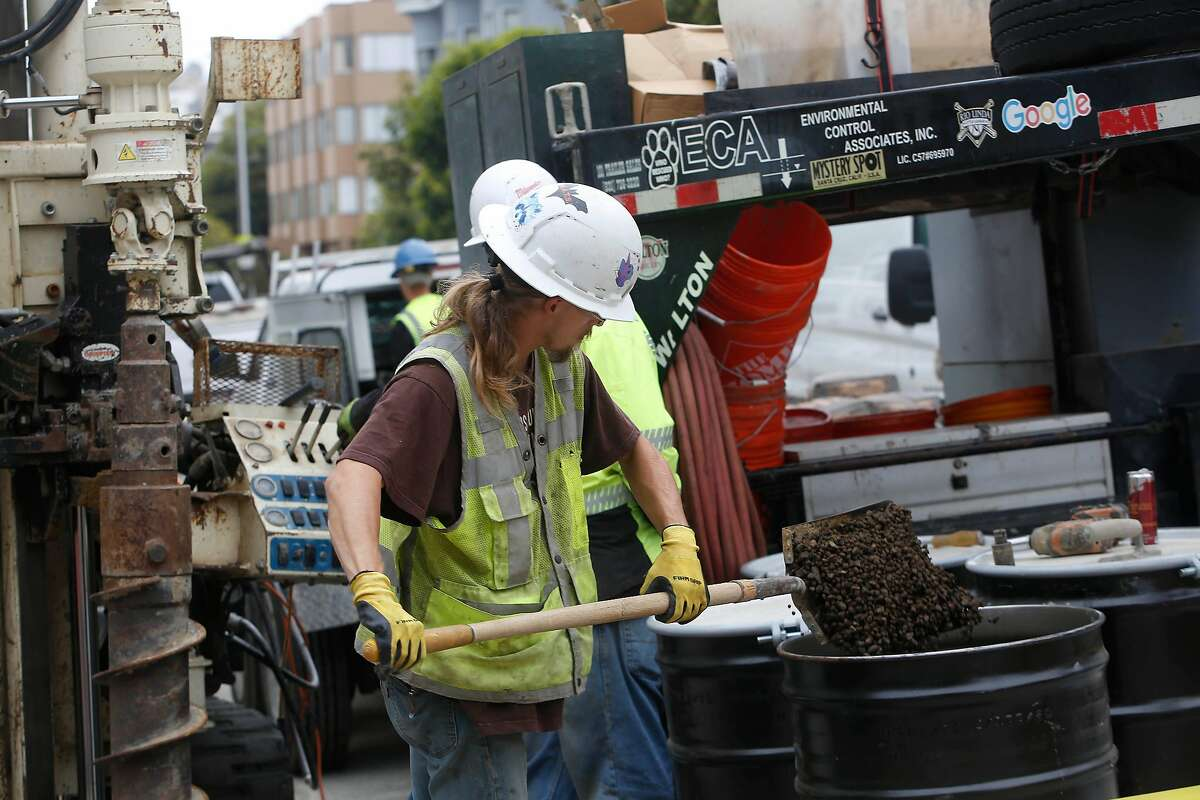 Laborers work in front of 1776 Green Street as a worker places dirt removed from the sidewalk into a barrell on Tuesday, August 11, 2020 in San Francisco, Calif. A Cow Hollow neighborhood group is contesting excavation work being done at 1776 Green Street saying that the city is not following state environmental law.