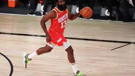 Houston Rockets guard James Harden (13) brings the ball upcourt in the first half of an NBA basketball game Wednesday, Aug. 12, 2020, in Lake Buena Vista, Fla. (Kim Klement/Pool Photo via AP)
