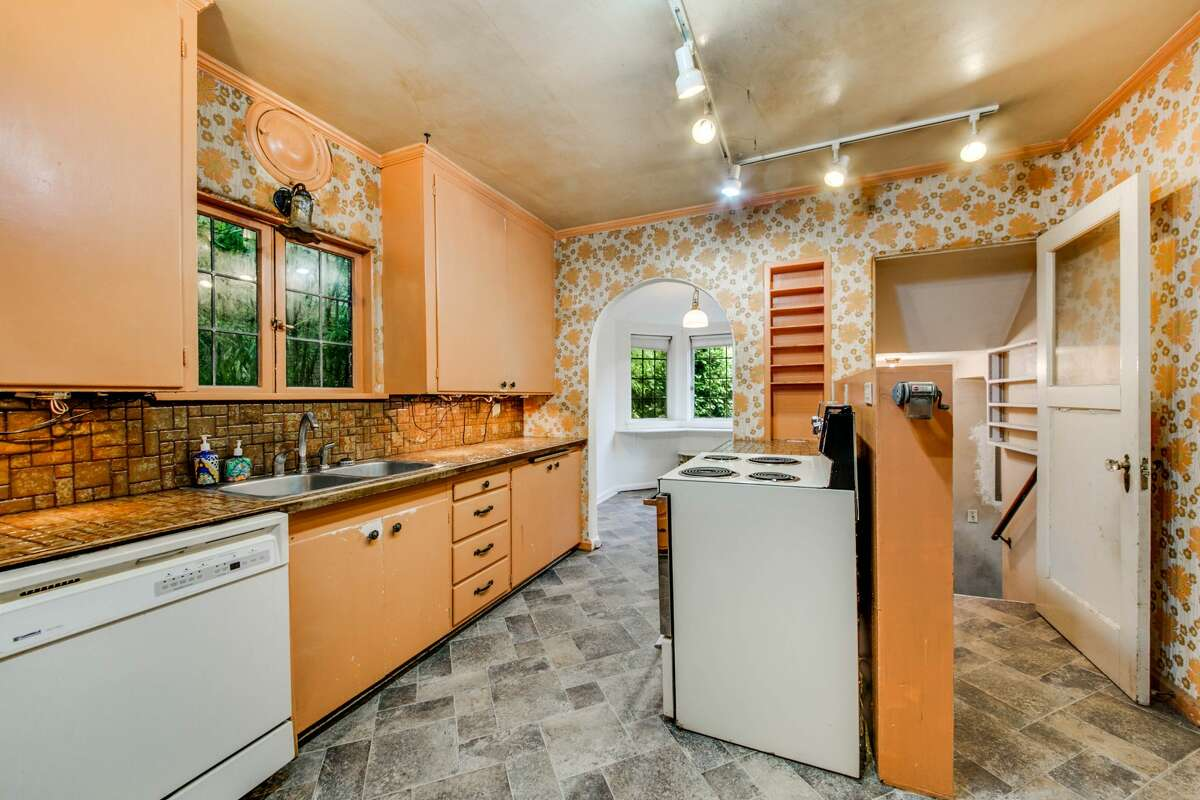 The kitchen is a full throttle train ride to the 1970s, but it's not hard to picture inventive ways to bring the space a little more up to date.