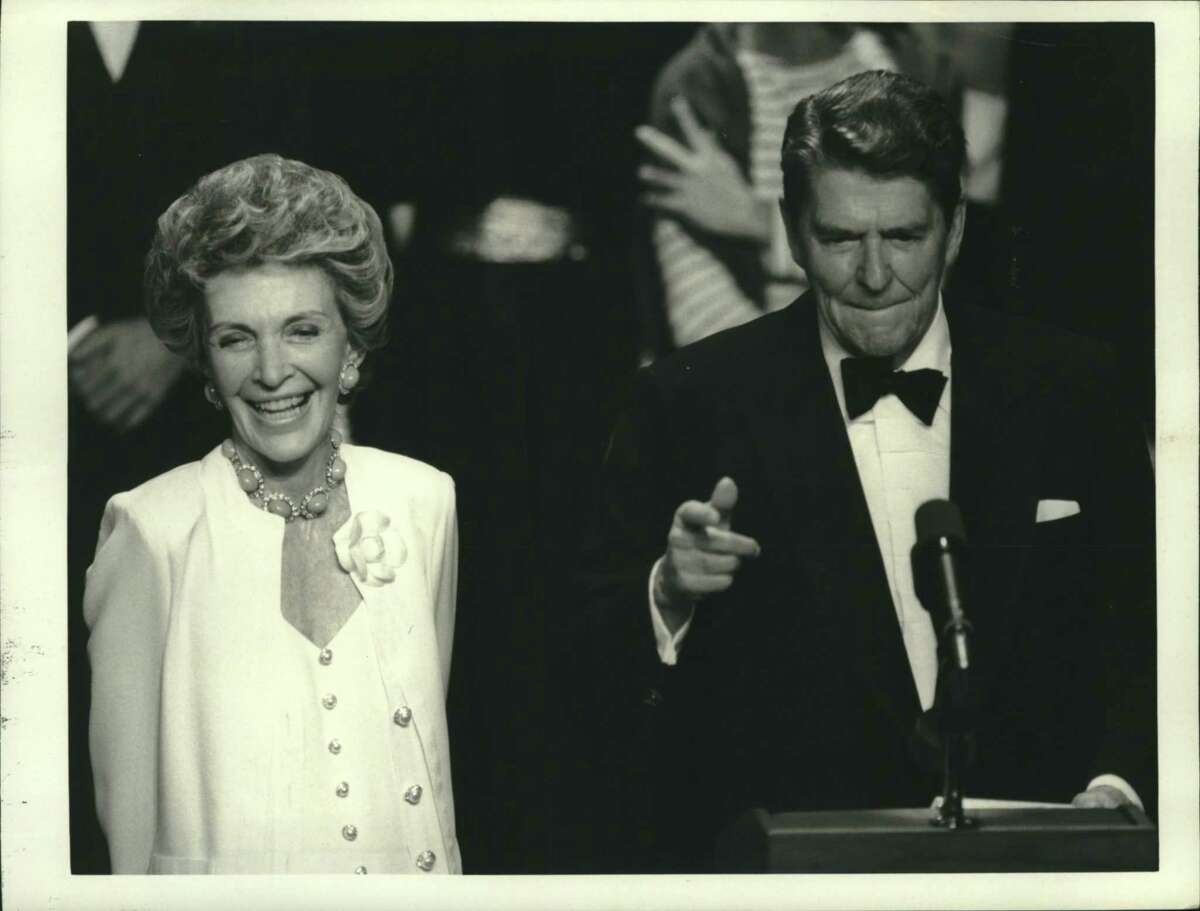 """President Ronald Reagan and first lady Nancy Reagan are entertained by a cavalcade of stars in this undated photo. Norwalk Community College history and political science professor Steven S. Berlizzi wrote in an op-ed that even though Reagan was polarizing, """"his affability and sense of humor comforted many Americans, leading to significant national unity"""" during his administration."""