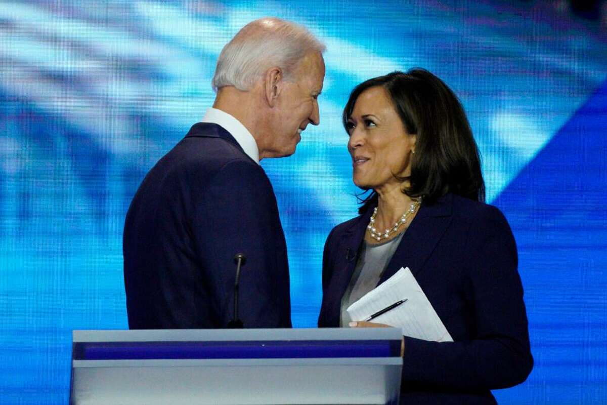 In this Sept. 12, 2019, file photo, Democratic presidential candidate former Vice President JoeBiden, left, and then-candidate Sen. Kamala Harris, D-Calif. shake hands after a Democratic presidential primary debate hosted by ABC at Texas Southern University in Houston. Biden has chosen Harris as his running mate.
