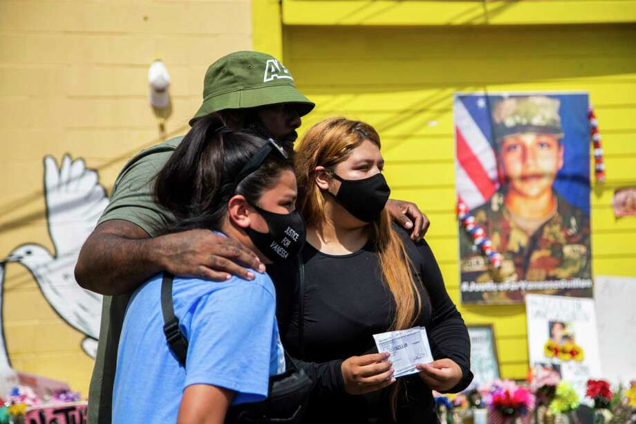 Lupe Guillén and her sister Mayra Guillén meet up with rapper Trae tha Truth, center, at a mural and makeshift memorial in honor of Vanessa Guillén to receive a gift from him on Wednesday, Aug. 12, 2020, in Houston. The rapper presented them a $30,000 check as a way to support their efforts to get justice for their sister Vanessa Guillén, who was presumably murdered at the Fort Hood military base in April. Photo: Marie D. De Jesús, Staff Photographer / © 2020 Houston Chronicle
