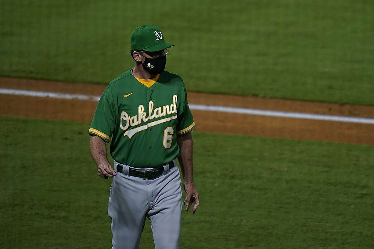 Oakland Athletics manager Bob Melvin heads back to the dugout after relieving starting pitcher Sean Manaea during the third inning of a baseball game against the Los Angeles Angels, Monday, Aug. 10, 2020, in Anaheim, Calif. (AP Photo/Jae C. Hong)