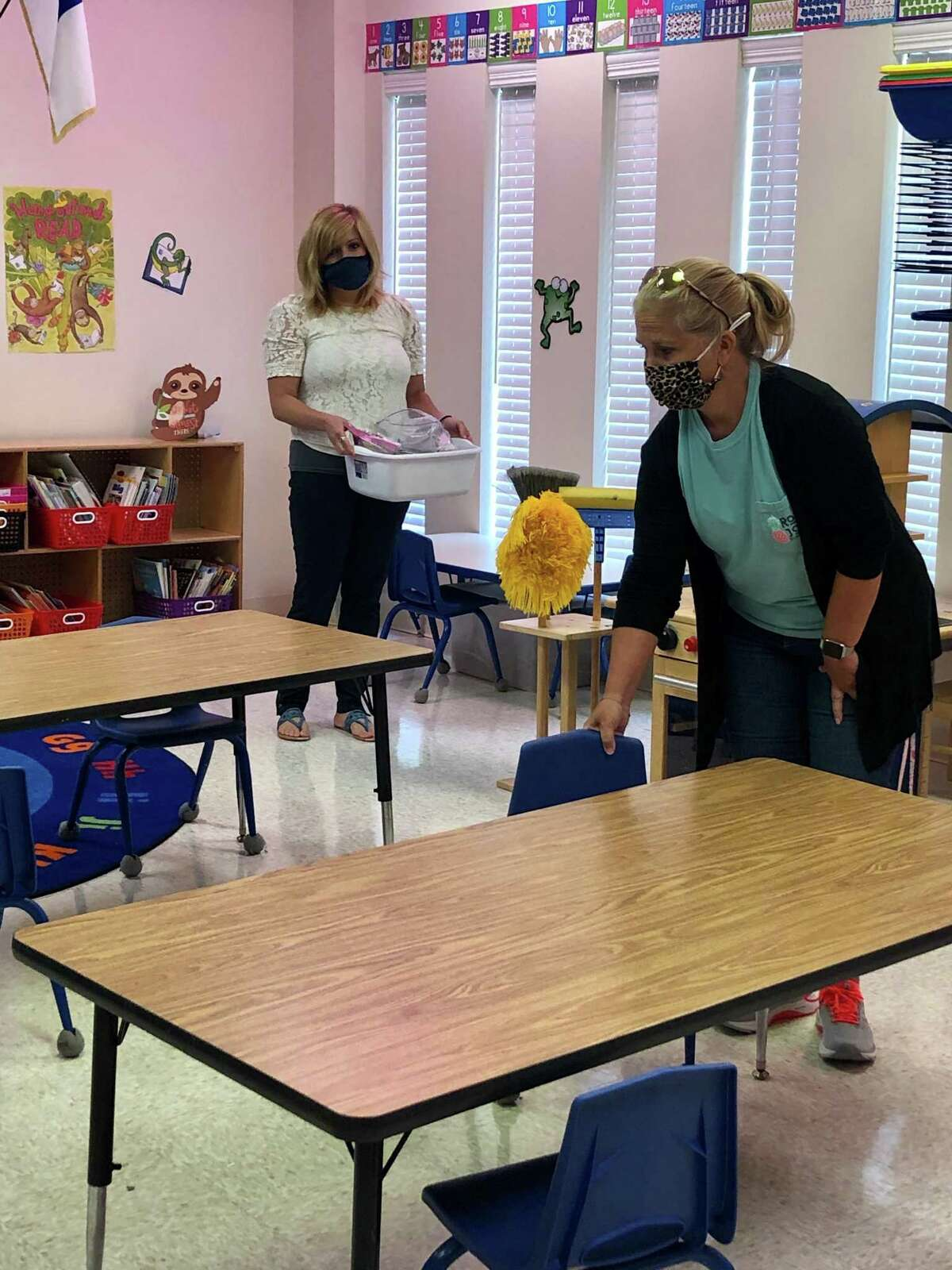 Lutheran South Academy early childhood teachers help each other prepare classrooms for students to return in-person on Aug. 19.