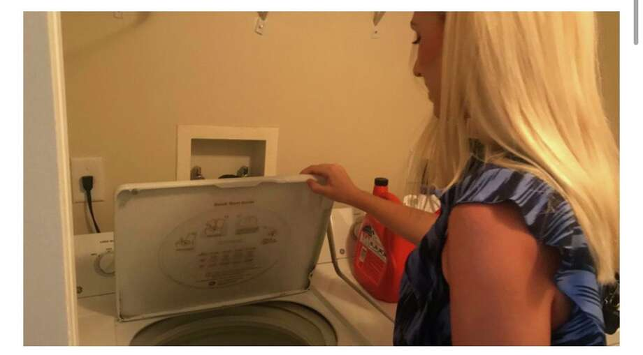 Branford native Emily Visnic was pretty shocked the other day when she opened the lid to the washing machine in her West Palm Beach, Fla., studio apartment to find a live python coiled up on top of her damp clothing. Photo: Emily Visnic / Contributed Photo