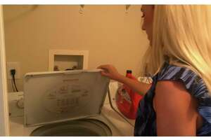 Branford native Emily Visnic was pretty shocked the other day when she opened the lid to the washing machine in her West Palm Beach, Fla., studio apartment to find a live python coiled up on top of her damp clothing.