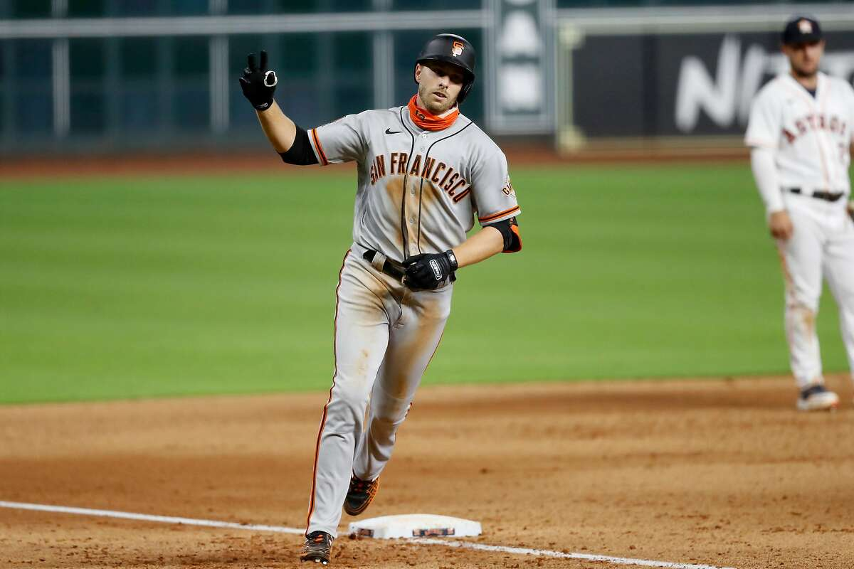 HOUSTON, TEXAS - AUGUST 10: Austin Slater #13 of the San Francisco Giants hits a solo home run in the eighth inning against the Houston Astros at Minute Maid Park on August 10, 2020 in Houston, Texas. (Photo by Tim Warner/Getty Images)