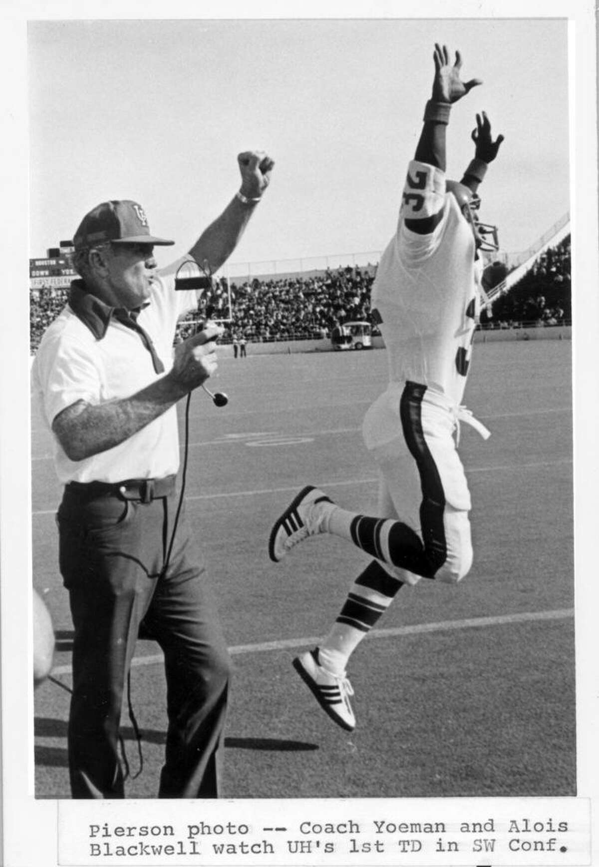 Bill Yeoman and Alois Blackwell celebrate UH's first touchdown in the Southwest Conference. The score was made with a 4-yard run by quarterback Danny Davis against the Baylor Bears in Waco in 1976.