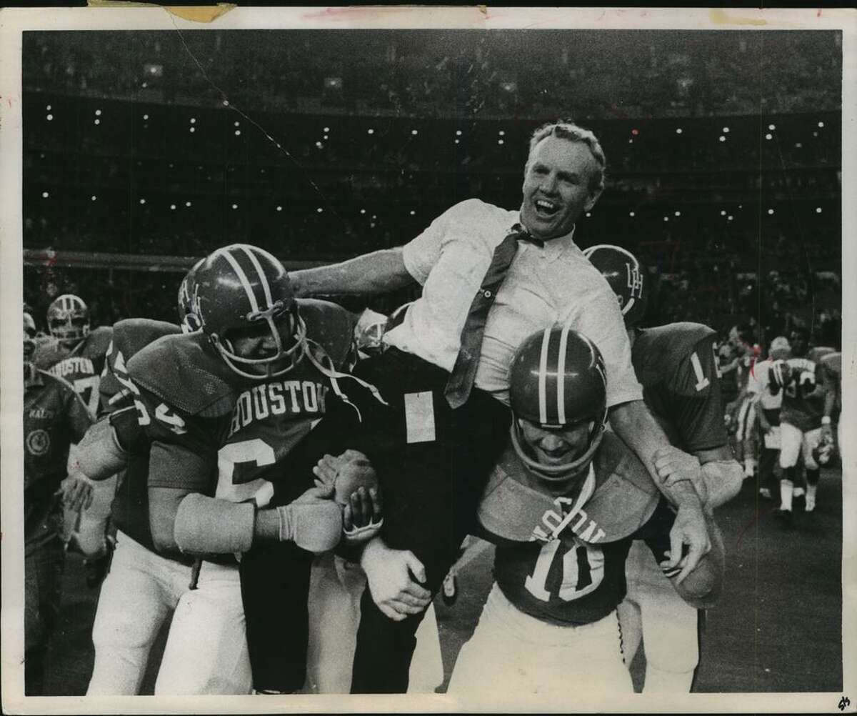 Bill Yeoman is carried off the field by UH Butch Brezina (64) and Ken Bailey (10) after beating Auburn in the 1969 Bluebonnet Bowl