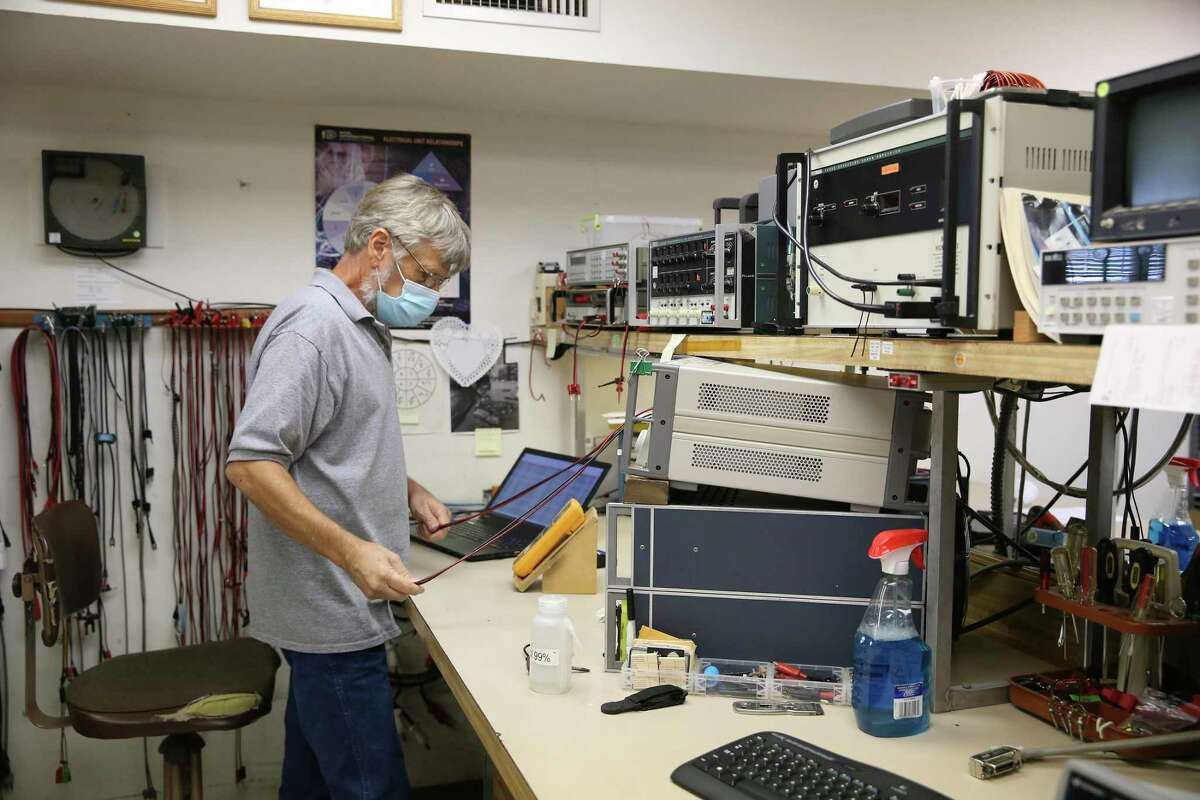 Rothe Development, Inc., Lab Manager Pete Stemmermann works in the calibration lab, Monday, Aug. 10, 2020.