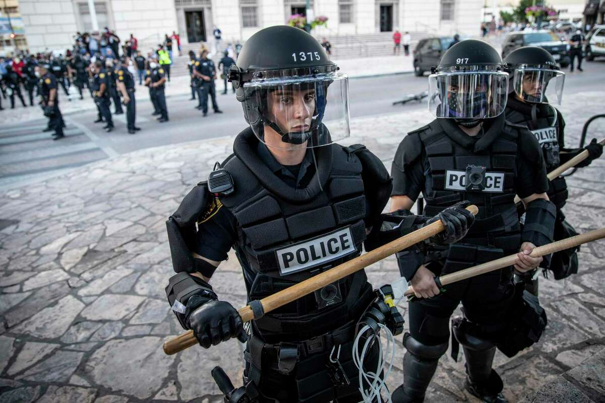 Since the killing of an unarmed Black man, George Floyd, while in Minneapolis police custody, protesters have taken to the streets in cities across the country, including San Antonio, and raised issues about police funding and use of force. San Antonio police stood ready for protests to escalate in downtown on May 30, 2020.