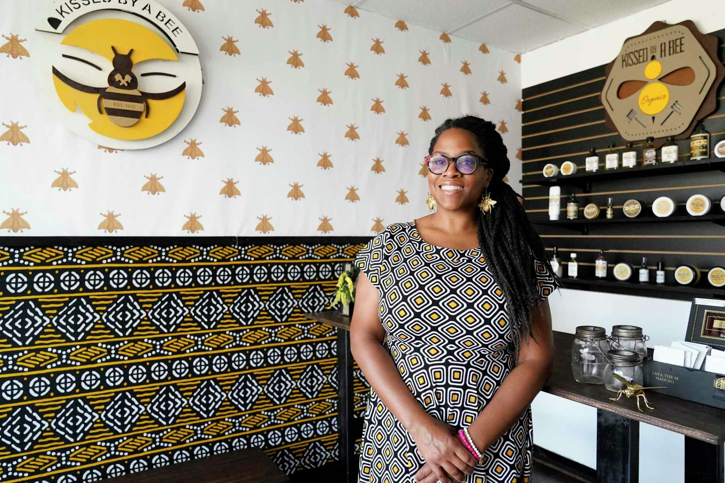 Akilah Scott-Amos, owner of Kissed By A Bee Organics,19237 Northpine Rd., is shown Wednesday, July 22, 2020, in Spring. She grows ingredients in her backyard that she uses in her skincare and health products.