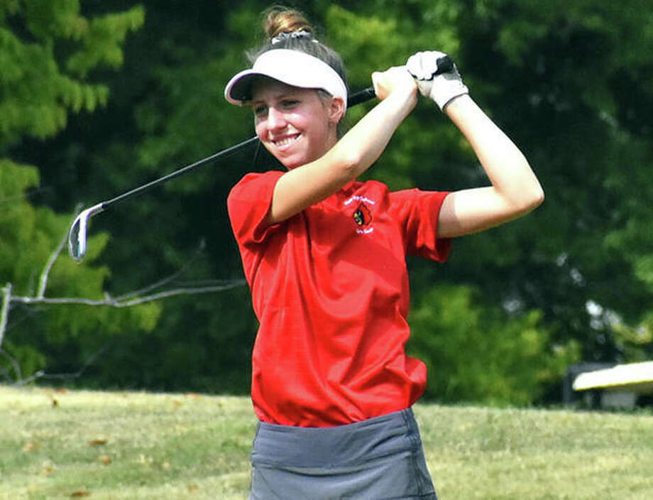 Alton's Natalie Messinger smiles when her tee shot on the par 3, 14th hole hits the green at Orchards Golf Course during last season's Mascoutah Class 2A Regional. Messinger won the regional with a 75 and returns as a senior to lead the Redbirds in 2020. Photo: Matt Kamp / Hearst Illinois