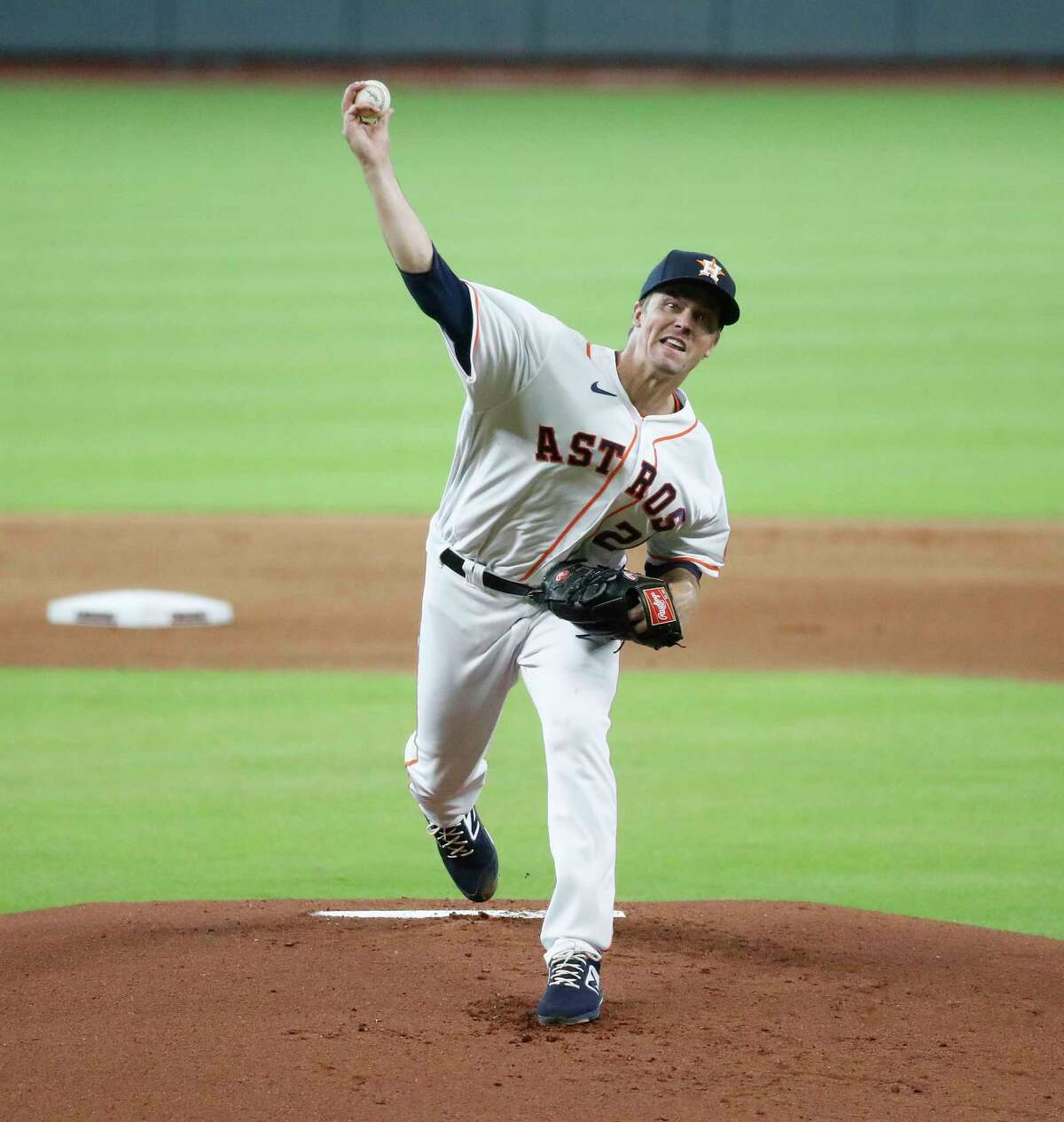 Houston Astros pitcher Zack Greinke pitches during the first inning of an MLB baseball game at Minute Maid Park, Wednesday, August 12, 2020, in Houston.