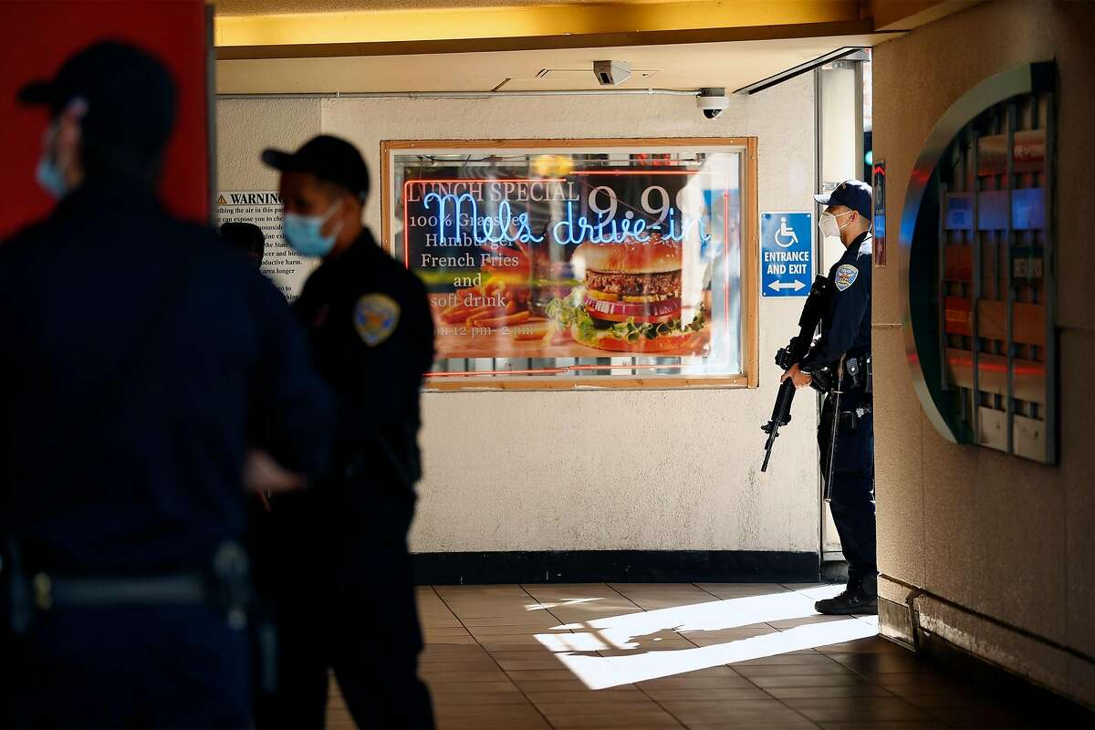 San Francisco Police search for shooting suspect in parking garage at 5th and Mission Street in San Francisco, Calif., on Wednesday, August 12, 2020.