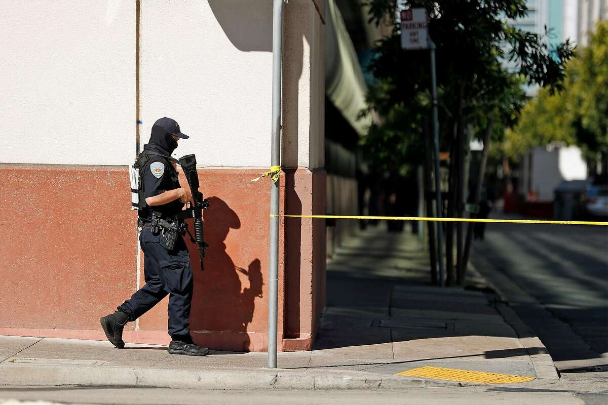 San Francisco Police search for shooting suspect in parking garage at 5th and Mission Street in San Francisco, Calif., on Wednesday, August 12, 2020. As homicides rise throughout the Bay Area during the coronavirus outbreak, San Francisco police have reported 45 killings so far this year, compared to 41 for all of 2019.