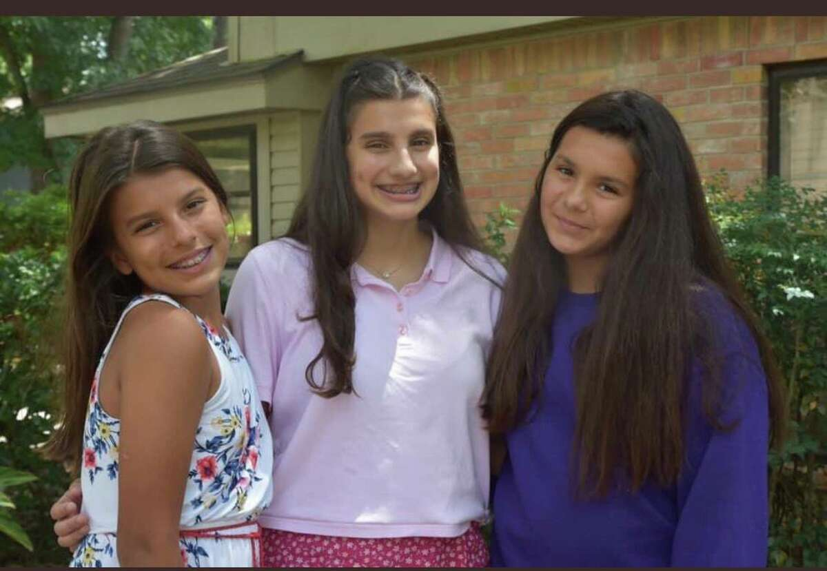 From left to right, Sydney Ortiz, Kathleen Ortiz, and Maya Ortiz take a family picture on the first day of the 2020-2021 school year. The Ortiz girls plan to return to campus on Aug. 24 when Humble ISD students are allowed back.