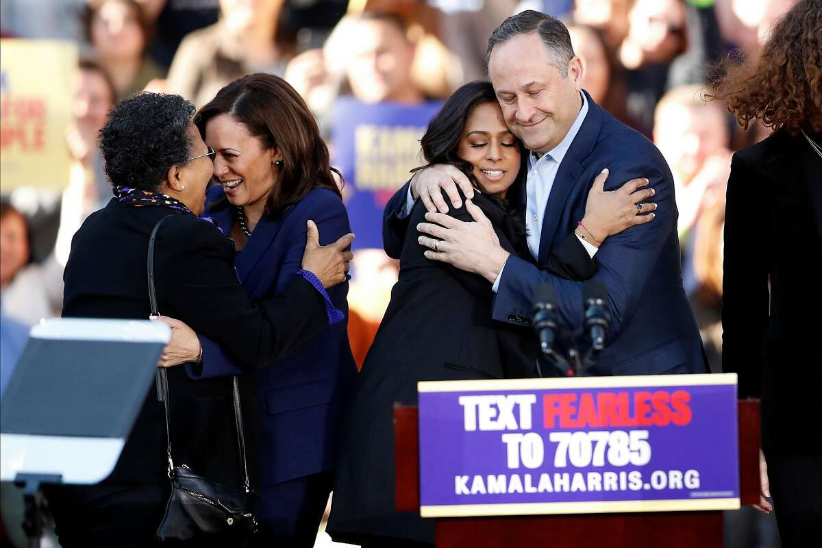 As Kamala Harris hugs a woman, her husband, Douglas Emhoff, hugs Harris' sister, Maya Harris after the California Senator launched her presidential campaign at a rally at Frank Ogawa Plaza in Oakland, Calif., on Sunday, January 27, 2019.