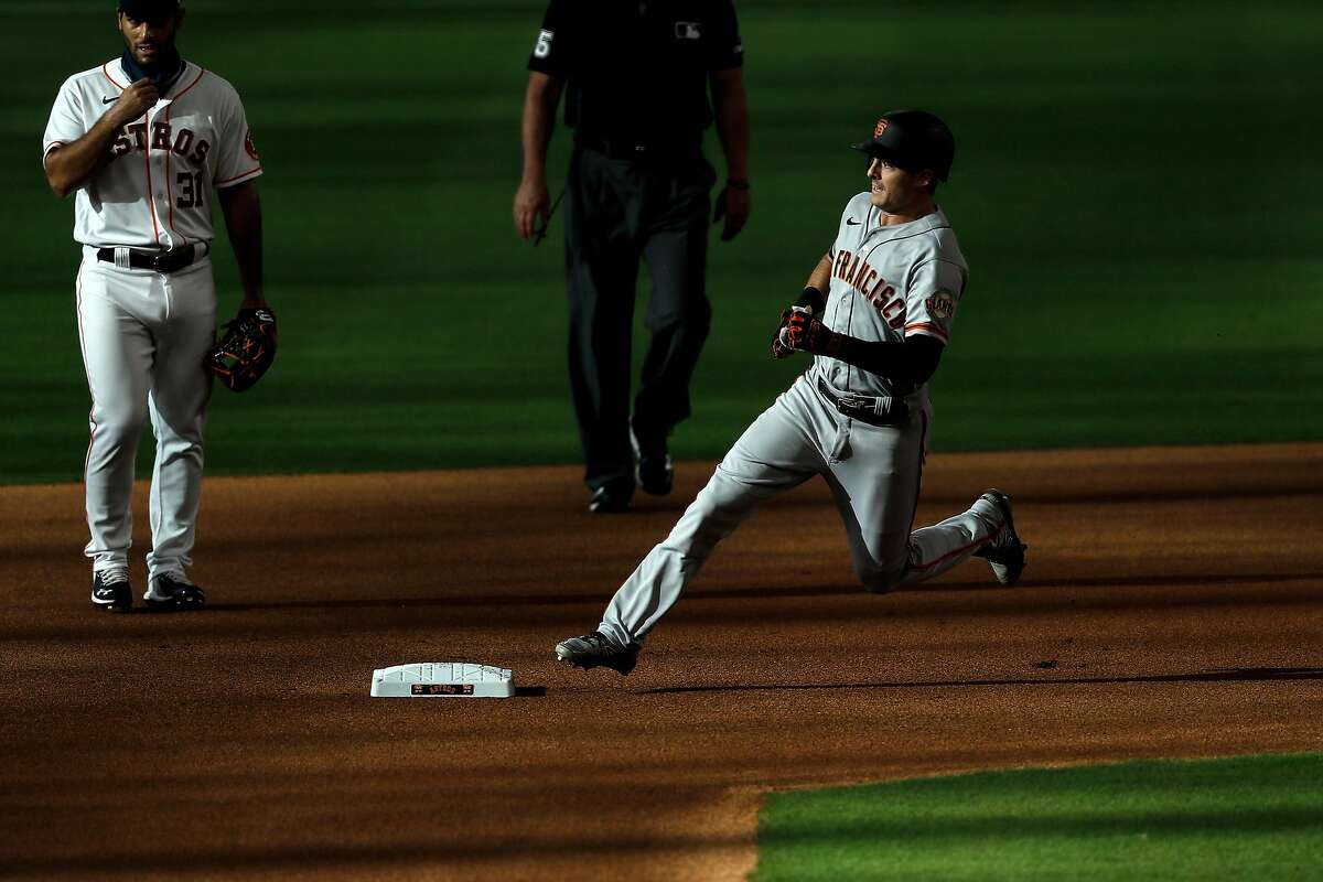 HOUSTON, TEXAS - AUGUST 12: Mike Yastrzemski #5 of the San Francisco Giants runs the bases on a triple in the first inning against the Houston Astros at Minute Maid Park on August 12, 2020 in Houston, Texas. (Photo by Tim Warner/Getty Images)