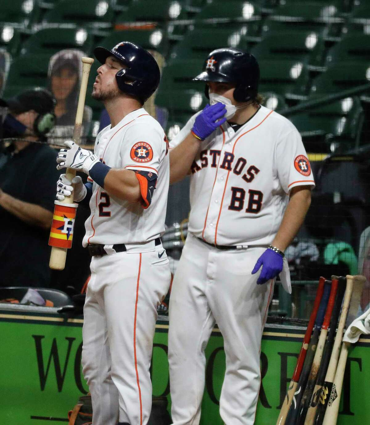 Houston Astros Alex Bregman blows on his bat in the on deck circle during the sixth inning of an MLB baseball game at Minute Maid Park, Wednesday, August 12, 2020, in Houston.