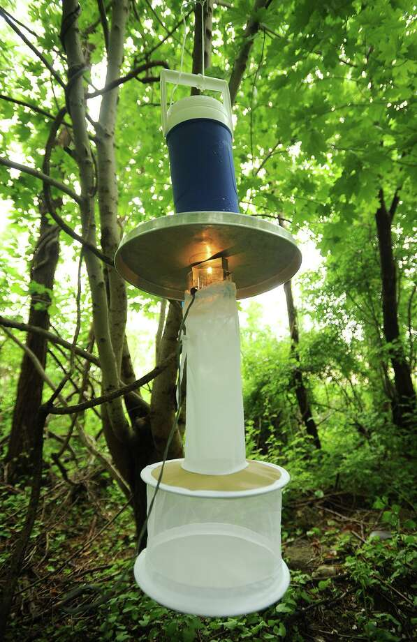 File photo of a mosquito sampling trap, known as a light trap, taken near DeLuca Field on Main Street in Stratford, Conn., on Monday, June 1, 2015. The Connecticut Agricultural Experiment Station collects mosquitoes every year from a wide range of locations to track West Nile Virus. This is not necessarily the type of trap installed in Bridgeport, Conn., in 2020. Photo: Brian A. Pounds / Hearst Connecticut Media / Connecticut Post