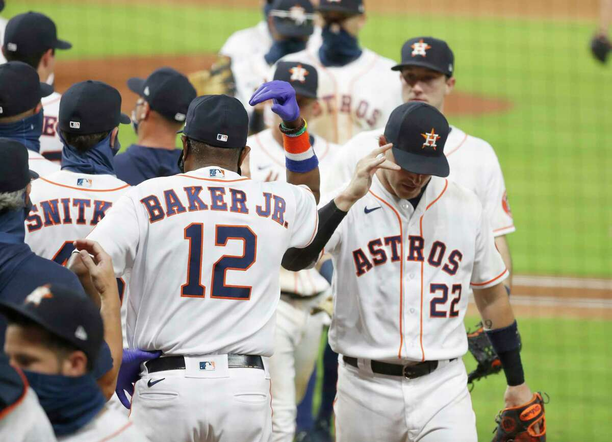 Houston Astros manager Dusty Baker and Houston Astros right fielder Josh Reddick celebrate the Astros 5-1 win over San Francisco Giants after the ninth inning of an MLB baseball game at Minute Maid Park, Wednesday, August 12, 2020, in Houston. Astros won 5-1.
