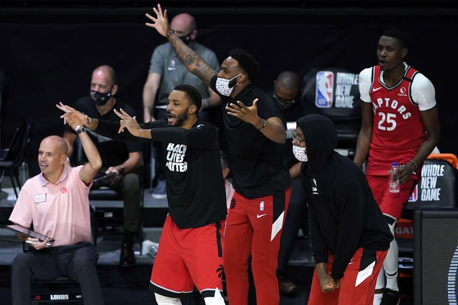 The Raptors bench supports their team during a win over the 76ers in Lake Buena Vista, Fla. Photo: Ashley Landis / Associated Press