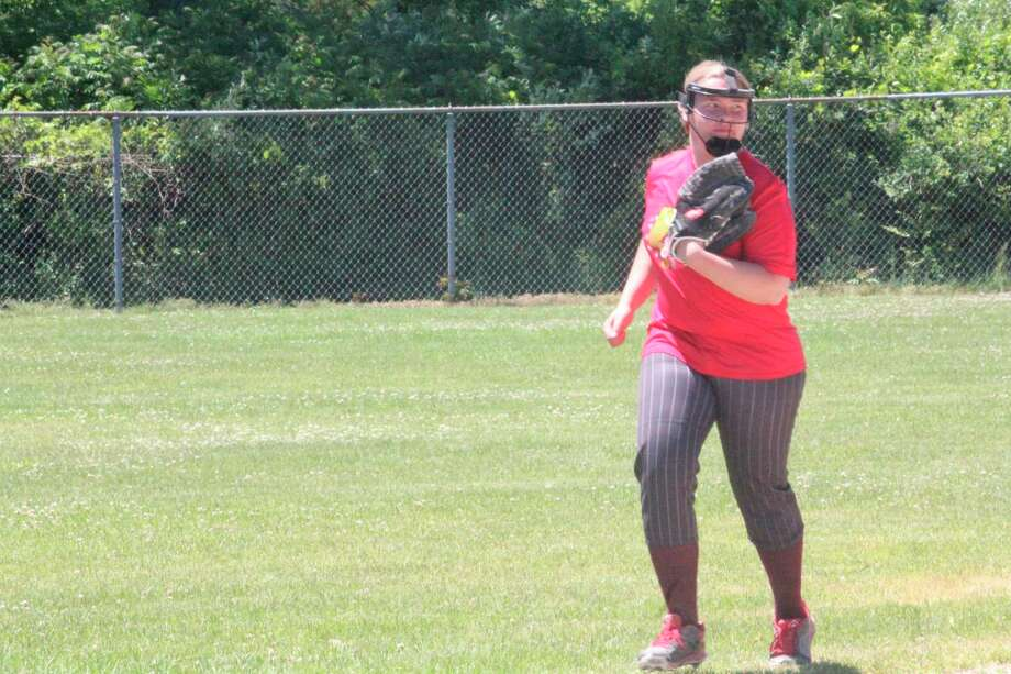 Evart's Veronica Lofquist goes over to her position during a recent Michigan Expos softball practice at Vogel Fields in Big Rapids. (Herald Review photo/John Raffel)