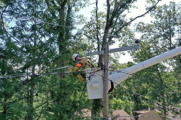 """Ten days after after Tropical Storm Isaias tore through Connecticut, hundreds of Eversource customers remain without power on Thursday, Aug. 13, 2020. Eversource said the remaining outages are """"more complex and take additional time to complete."""""""